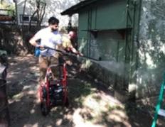 Man spraying house