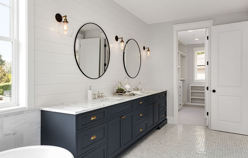 White bathroom with blue cabinets